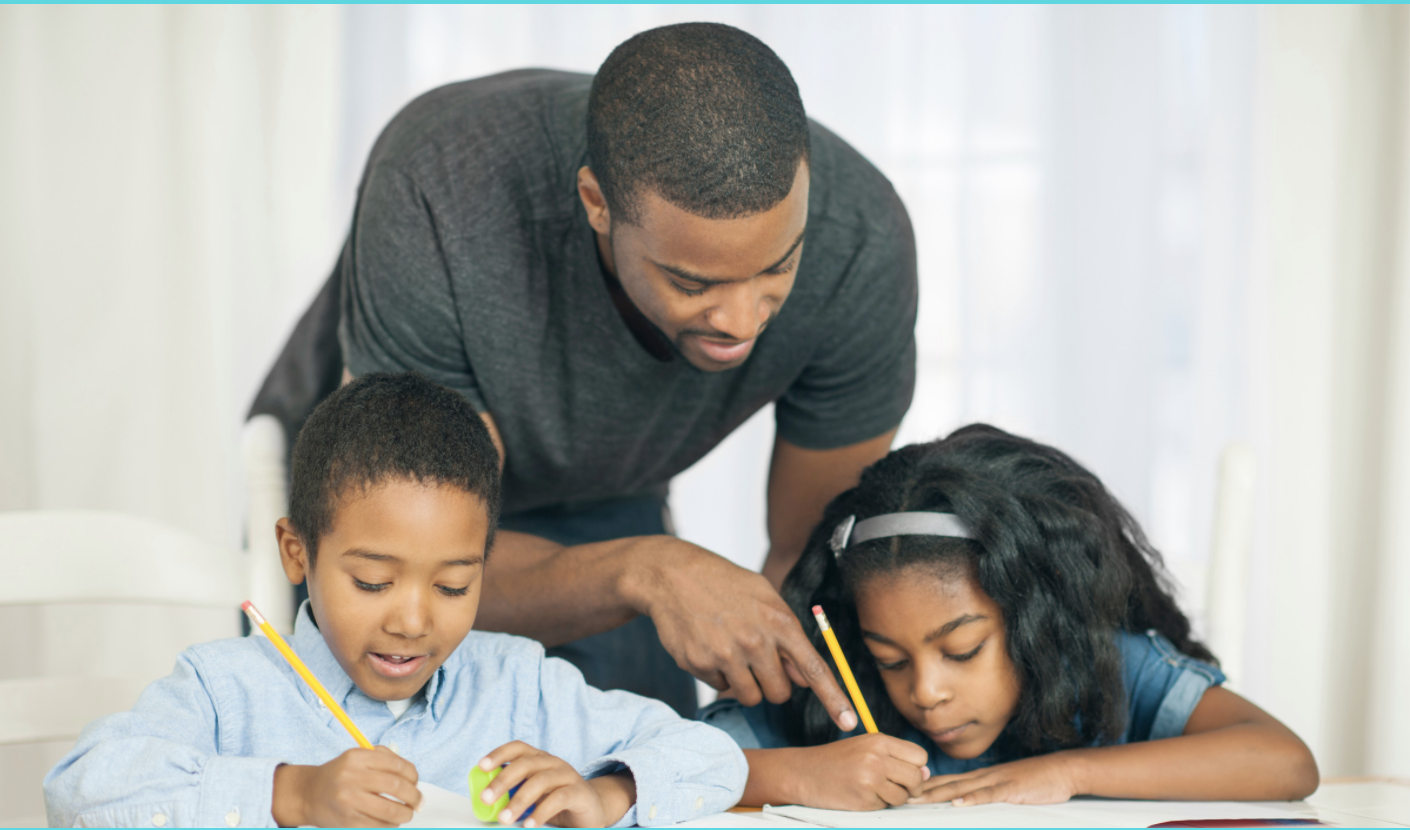Distance learning etiquette for parents. A father helps children with schoolwork.